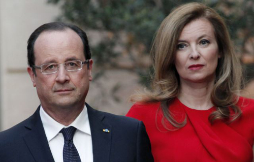 French President Francois Hollande (left) and his former-companion Valerie Trierweiler arrive for a state dinner at the Elysee Palace in Paris (file photo). /Reuters