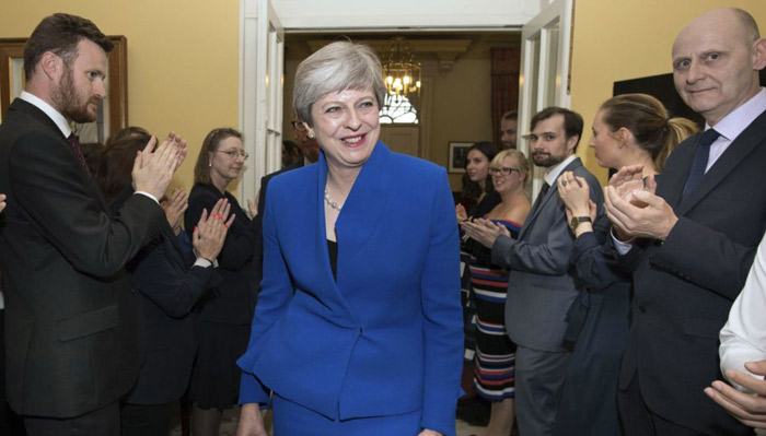 Conservatives lead, but Labour gains big in British election, exit polls show