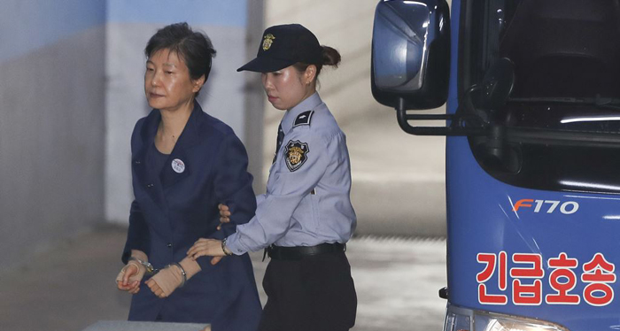 Ex-South Korean president views corruption trial as