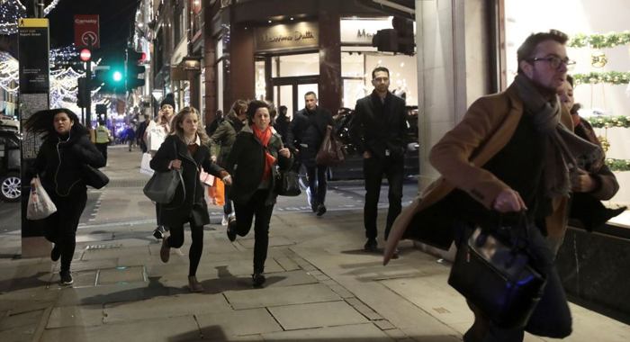 Armed cops evacuate Oxford Circus Tube station as people run from scene