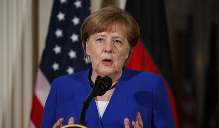 Merkel: Deal with Iran will not suspend nuclear program