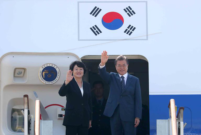 Koreas agree to march together at Asian Games